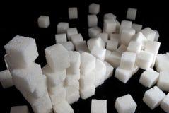 Pila de cubos del azúcar blanco Fotografía de archivo
