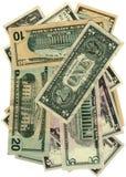 Pila de dólares aislados en el blanco, abundancia de los ahorros Imágenes de archivo libres de regalías