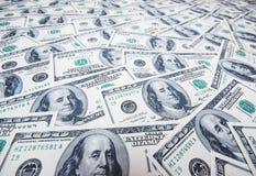 Pila de dólares como fondo Imagen de archivo libre de regalías