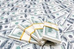 Pila de dólares en el dinero Imagen de archivo libre de regalías