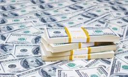 Pila de dólares en el dinero Fotografía de archivo
