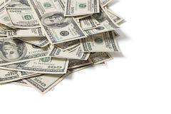 Pila de dólares en el fondo blanco Foto de archivo libre de regalías