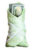 Pila de dólares en una manta del bebé Fotos de archivo