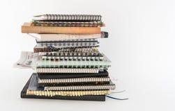 Pila de diarios de la escritura Imagenes de archivo