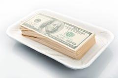 Pila de dinero en el empaquetamiento al vacío Imagen de archivo libre de regalías