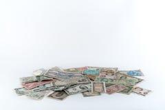 Pila de dinero en el fondo blanco Imágenes de archivo libres de regalías