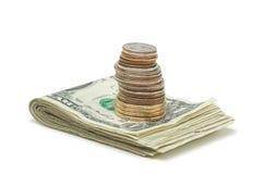 Pila de dinero y de monedas Imagen de archivo libre de regalías