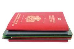 Pila de documentos con el pasaporte Foto de archivo libre de regalías
