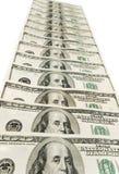 Pila de dólares americanos aislados en blanco Imágenes de archivo libres de regalías