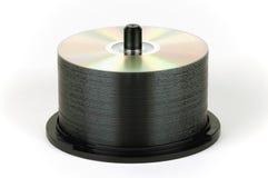 Pila de DVD en el eje de rotación fotos de archivo
