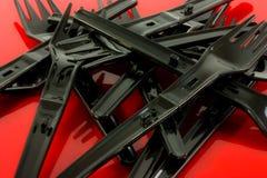 Pila de forkes plásticas Foto de archivo libre de regalías
