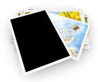 Pila de fotos con la foto en blanco Imágenes de archivo libres de regalías