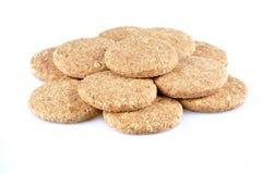 Pila de galletas enteras del grano aisladas en el fondo blanco Fotos de archivo libres de regalías