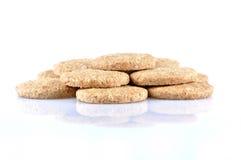 Pila de galletas enteras del grano aisladas en el fondo blanco Fotografía de archivo libre de regalías