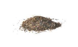 Pila de granos dispersados del té verde Foto de archivo libre de regalías
