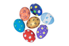 Pila de huevos de Pascua hechos a mano coloridos aislados en blanco Fotos de archivo