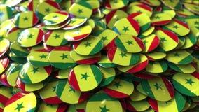 Pila de insignias que ofrecen banderas de Senegal stock de ilustración