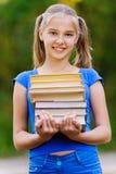 Pila de la explotación agrícola de la muchacha del adolescente Imagen de archivo libre de regalías