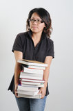 Pila de la explotación agrícola de la mujer de libros Fotos de archivo