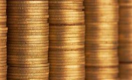 Pila de la moneda de oro Foto de archivo libre de regalías