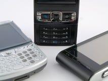 Pila de la pila de varios teléfonos móviles modernos PDA Imagen de archivo libre de regalías
