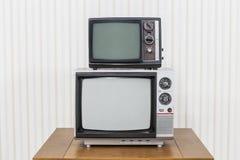 Pila de la televisión del vintage Fotografía de archivo