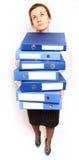 Pila de la tenencia de la mujer de carpetas Imágenes de archivo libres de regalías