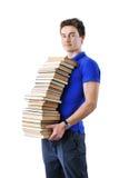 Pila de la tenencia del adolescente de libros aislados sobre blanco Fotos de archivo libres de regalías