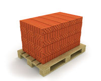 Pila de ladrillos anaranjados en la paleta Fotografía de archivo libre de regalías