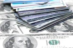 Pila de las tarjetas y de la muñeca de crédito Foto de archivo libre de regalías