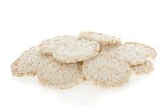 Pila de las tortas de arroz de la dieta en blanco Imágenes de archivo libres de regalías