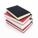 Pila de libros aislados Imagen de archivo libre de regalías