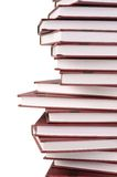 Pila de libros aislados en blanco foto de archivo libre de regalías