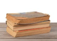 Pila de libros aislados en blanco foto de archivo