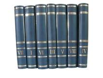Pila de libros aislados en el fondo blanco Fotos de archivo libres de regalías