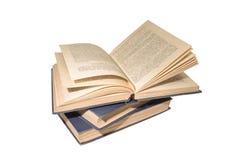 Pila de libros aislados en un fondo blanco Fotografía de archivo