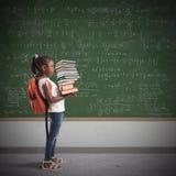 Pila de libros de la matemáticas para un niño imagen de archivo libre de regalías