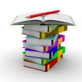 Pila de libros en el fondo blanco Fotos de archivo libres de regalías