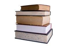 Pila de libros en el fondo blanco. Imágenes de archivo libres de regalías