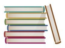 Pila de libros en un fondo blanco Imágenes de archivo libres de regalías