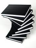 Pila de libros negros Imagen de archivo libre de regalías
