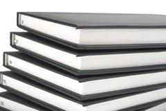 Pila de libros negros Fotografía de archivo libre de regalías