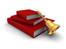 Pila de libros roja con la manija Bell de la escuela Imágenes de archivo libres de regalías