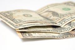 Pila de los billetes de dólar uno en el fondo blanco Fotografía de archivo