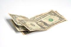 Pila de los billetes de dólar uno en el fondo blanco Fotografía de archivo libre de regalías