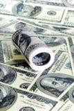 Pila de los dólares del rollo como fondo Foto de archivo
