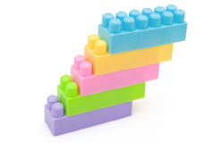 Pila de los ladrillos del juguete junto Imagen de archivo