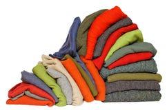 Pila de los suéteres del invierno o de la caída de los hombres Imagen de archivo libre de regalías