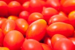 Pila de los tomates de cereza Fotos de archivo