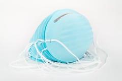Pila de máscaras de polvo azules Fotos de archivo libres de regalías